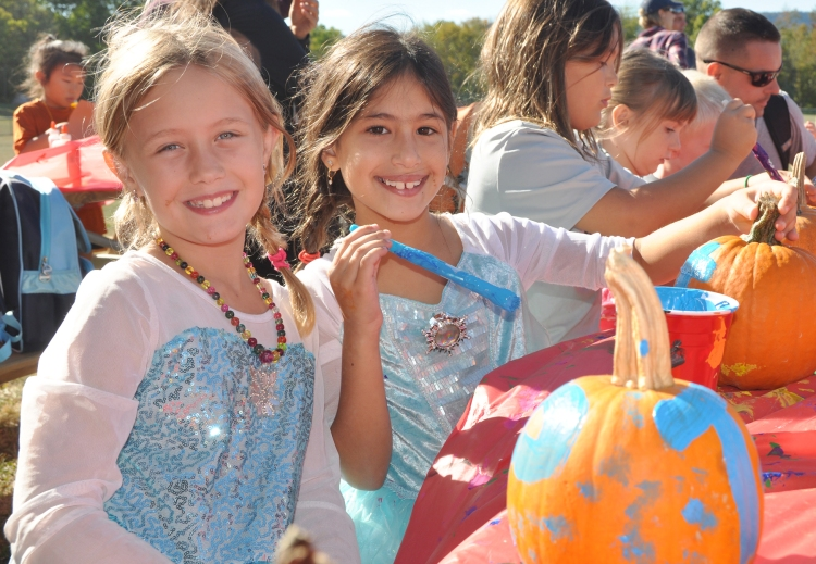 Tierney Reed and Priya Crystal paint pumpkins at last Saturday's New Paltz Central School District's Foundation for Student Enhancement kids event at the Field of Dreams.